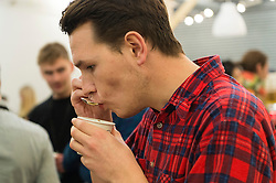 © Licensed to London News Pictures. 07/04/2016. A visitor coffee cupping at The London Coffee Festival. Now its 4th year, will attract over 35,00 visitors over the four day event. London, UK. Photo credit: Ray Tang/LNP