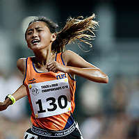 Vanessa Lee of National University of Singapore reacts as she crosses the finish line during the women's 5000m event. (Photo &copy; Lim Yong Teck/Red Sports) The 2018 Institute-Varsity-Polytechnic Track and Field Championships were held over three days in January.<br />