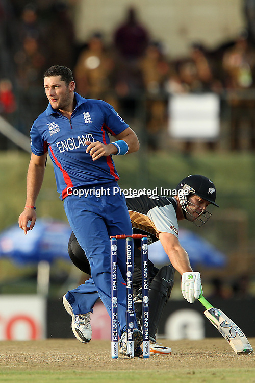 Tim Brenan of England waits for the ball as James Franklin touches down during the ICC World Twenty20 Super 8s match between England and New Zealand held at the  Pallekele Stadium in Kandy, Sri Lanka on the 29th September 2012<br /> <br /> Photo byRon Gaunt/SPORTZPICS/PHOTOSPORT
