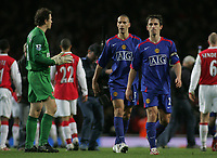 Photo: Paul Thomas.<br /> Arsenal v Manchester United. The Barclays Premiership. 21/01/2007.<br /> <br /> Rio Ferdinand and Gary Neville (R) walk past Arsenal keeper Jens Lehmann (L) after the match declining to shake his hand.