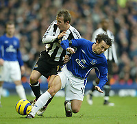 Photo: Aidan Ellis.<br /> Everton v Newcastle. The Barclays Premiership.<br /> 27/11/2005.<br /> Everton's Simon Davis puts in a strong challenge on Newcastle's Leee Bowyer