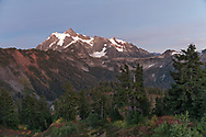 An early October evening - post sunset in Washington State's North Cascades Range featuring Mount Shuksan. Photographed from Huntoon Point on Kulshan Ridge in the Mount Baker Wilderness. Mount Shuksan itself lies in North Cascades National Park.
