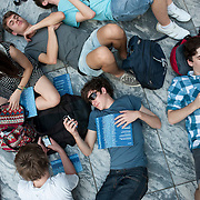 July 8, 2012 - New York, NY : A group of students from Perth, Australia (they had actually just come from the airport) including Connor Lynch, center, and Josh Croker, right, relax and read their programs in the Abby Aldrich Rockefeller Sculpture Garden at the Modern Museum of Art in Manhattan on Sunday evening, as they wait to hear the New Juilliard Ensemble perform in the first of MoMA's annual Summergarden concert series performances. CREDIT: Karsten Moran for The New York Timeson the first of MoMA's annual Summergarden concert series performances --  this evening, by the members and alumni of the New Juilliard Ensemble.  CREDIT: Karsten Moran for The New York Times