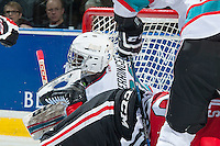 KELOWNA, CANADA - JANUARY 29: Michael Herringer #30 of Kelowna Rockets takes a skate to the face during a collision at the net against the Portland Winterhawks on January 29, 2016 at Prospera Place in Kelowna, British Columbia, Canada.  (Photo by Marissa Baecker/Shoot the Breeze)  *** Local Caption *** Michael Herringer;