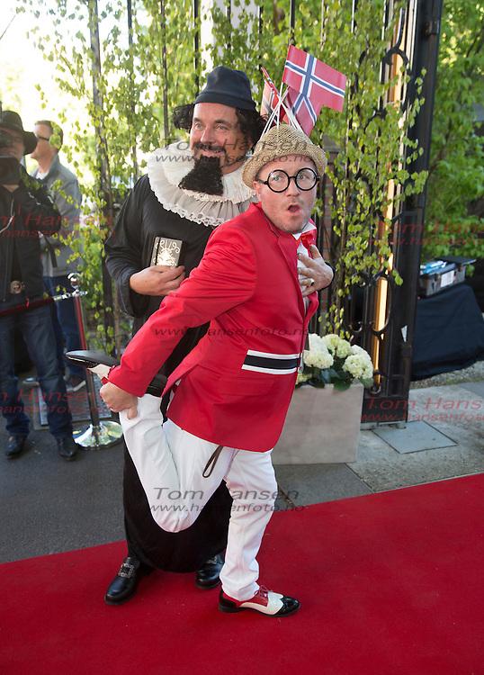 OSLO, 2014-5-16;  Barnetoget hilser kongefamilie på Petter Stordalen inviterer til tradisjonell 16.maifest med masse kjendiser.  Per Sundnes og samboeren Tore Lenngren. FOTO:  TOM HANSEN