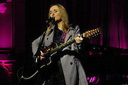 Grammy award winner Melissa Etheridge is presented with The Excellence in the Performing Arts award from the National Museum of Women in the Arts (NMWA) in Washington DC. Sunday Nov. 4, 2012. Etheridge also performed on the piano and then an acoustic set on guitar for an intimate audience of about 400 people. Photo ©Suzi Altman/For NMWA Grammy award winner Melissa Etheridge is presented with the National Museum of Women in the Arts' (NMWA) Award for Excellence in the Performing Arts in Washington DC. Sunday Nov. 4, 2012. Etheridge also performed on the piano and then an acoustic set on guitar for an intimate audience of about 300 people. Photo ©Suzi Altman/For NMWA<br />