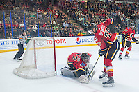 PENTICTON, CANADA - SEPTEMBER 17: Mason McDonald #72 of Calgary Flames makes a save against the Edmonton Oilers on September 17, 2016 at the South Okanagan Event Centre in Penticton, British Columbia, Canada.  (Photo by Marissa Baecker/Shoot the Breeze)  *** Local Caption *** Mason McDonald;
