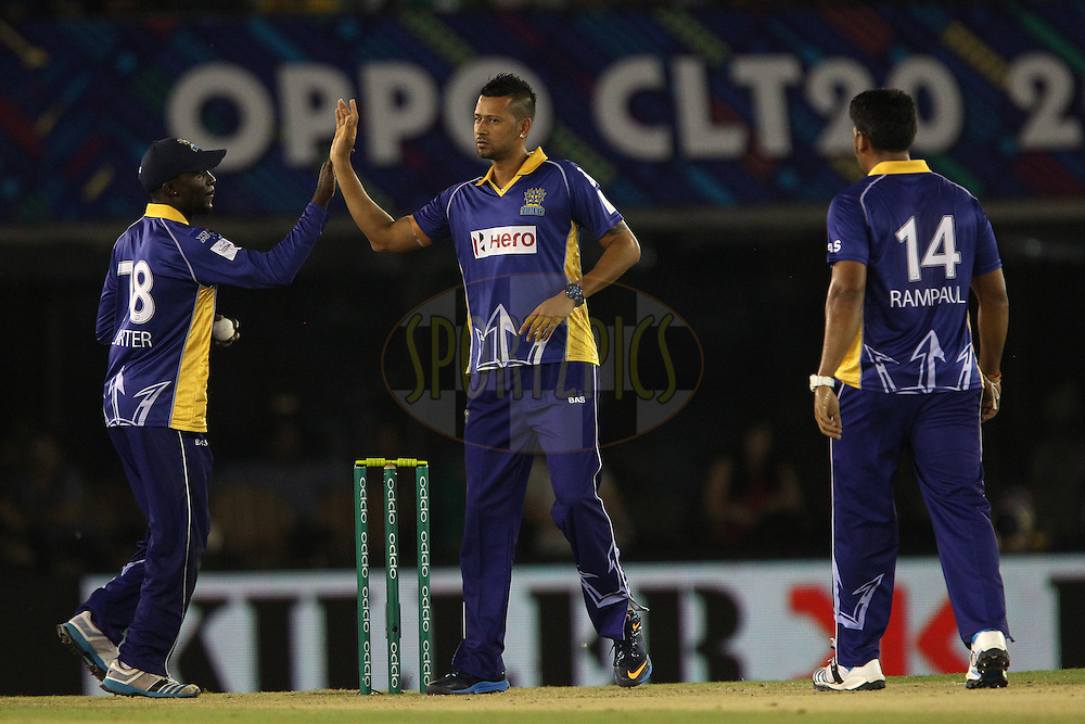 Rayad EMRIT (Captain) of the Barbados Tridents congratulates Jonathan CARTER of the Barbados Tridents on taking the catch to dismiss Manan VOHRA of the Kings XI Punjab during match 5 of the Oppo Champions League Twenty20 between the Kings XI Punjab and the Barbados Tridents held at the Punjab Cricket Association Stadium, Mohali, India on the 20th September 2014<br /> <br /> Photo by:  Ron Gaunt / Sportzpics/ CLT20<br /> <br /> <br /> Image use is subject to the terms and conditions as laid out by the BCCI/ CLT20.  The terms and conditions can be downloaded here:<br /> <br /> http://sportzpics.photoshelter.com/gallery/CLT20-Image-Terms-and-Conditions-2014/G0000IfNJn535VPU/C0000QhhKadWcjYs