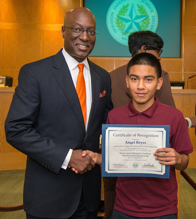 Houston ISD Interim Superintendent Ken Huewitt and Angel Reyes pose for a photograph during a meeting of the Board of Trustees, June 9, 2016.