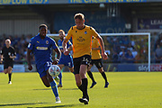 AFC Wimbledon attacker Michael Folivi (17) battles for possession with Bristol Rovers defender Tom Davies (16) during the EFL Sky Bet League 1 match between AFC Wimbledon and Bristol Rovers at the Cherry Red Records Stadium, Kingston, England on 21 September 2019.