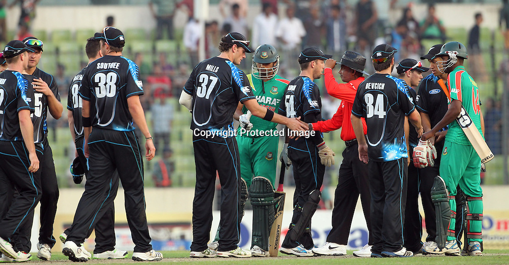 Kyle Mills shakes the umpires hand after the match, New Zealand Black Caps v Bangladesh, 1st and only T20 international cricket match at Shere Bangla National Stadium, Mirpur, Bangladesh. 6 November 2013. Photo: Shamsul Hoque Tanku/Photosport.co.nz