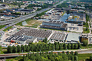 Nederland, Amsterdam, Amsterdam-Oost, 25-05-2010. Ringweg A10-Zuid kruist Duivendrechtse Vaart en Johan Muyskensweg, Amstel Business park.met Drukkerij PCM..luchtfoto (toeslag), aerial photo (additional fee required).foto/photo Siebe Swart