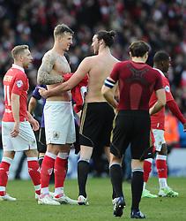 Bristol City's Aden Flint and West Ham's Andy Carroll swap shirts  - Photo mandatory by-line: Joe Meredith/JMP - Mobile: 07966 386802 - 25/01/2015 - SPORT - Football - Bristol - Ashton Gate - Bristol City v West Ham United - FA Cup Fourth Round