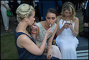 ELIZABETH ESTEVE; SASHA VOLKOVA; MEREDITH OSTROM, 2014 Serpentine's summer party sponsored by Brioni.with a pavilion designed this year by Chilean architect Smiljan Radic  Kensington Gdns. London. 1July 2014