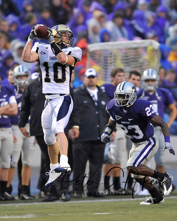 MANHATTAN, KS - SEPTEMBER 06:  Wide receiver Tyler Lulay #10 of the Montana State Bobcats leaps up to make a catch as defensive back Ray Cheatham of the Kansas State Wildcats #23 closes in for the tackle in the second quarter on September 6, 2008 at Bill Snyder Family Stadium in Manhattan, Kansas.  Kansas State won 69-10.