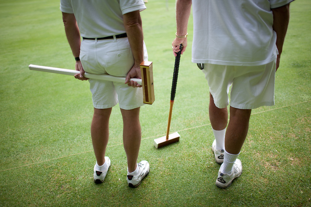 A pair of croquet players wait for their turns during the Berkshire Invitational tournament at the Lenox Croquet Club in Lenox, MA on June 10, 2011. (Matthew Cavanaugh / For The Boston Globe Magazine)