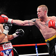 The WBO Super Featherweight Championship at the Kelvin Hall,. Ricky Burns  from Coatbridge  v Roman Martinez from Puerto Rico. At Kelvin Hall Glasgow. Burns lands a right on Martinez jaw.    Picture  Robert Perry  The Scotsman 4th Sept  2010
