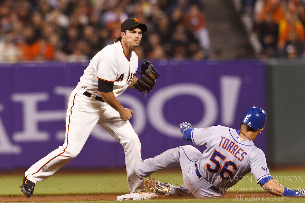 SAN FRANCISCO, CA - JULY 30: Ryan Theriot #5 of the San Francisco Giants completes a double play over Andres Torres #56 of the New York Mets during the fifth inning at AT&T Park on July 30, 2012 in San Francisco, California. The New York Mets defeated the San Francisco Giants 8-7 in 10 innings. (Photo by Jason O. Watson/Getty Images) *** Local Caption *** Ryan Theriot; Andres Torres