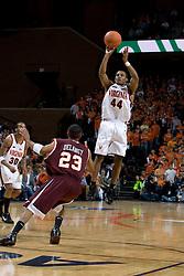Virginia guard Sean Singletary (44) shoots a three pointer over Virginia Tech guard Malcolm Delaney (23).  The Virginia Cavaliers men's basketball team fell to the Virginia Tech Hokies 70-69 in overtime at the John Paul Jones Arena in Charlottesville, VA on January 16, 2008.