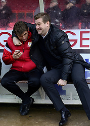 Milton Keynes Dons Manager, Karl Robinson shares a joke with his bench before the game - Photo mandatory by-line: Joe Meredith/JMP - Tel: Mobile: 07966 386802 18/01/2014 - SPORT - FOOTBALL - Ashton Gate - Bristol - Bristol City v MK Dons - Sky Bet League One