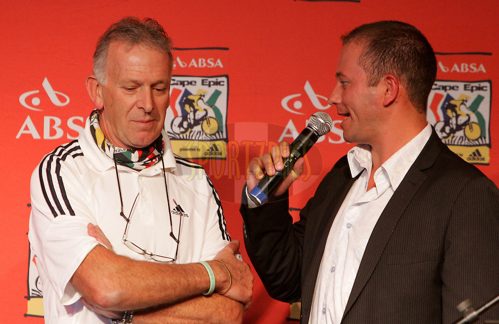 CAPE TOWN, SOUTH AFRICA - 27 October 2009 Leon Evans (Dr Evil) is interviewed by Dan Nichol during the official launch of the ABSA Cape Epic route for 2010 held at The Marimba Restaurant in the CTICC, Cape Town.Photo by: SPORTZPICS/ ABSA Cape Epic