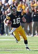 October 22, 2011: Iowa Hawkeyes quarterback James Vandenberg (16) scrambles with the ball during the first half of the NCAA football game between the Indiana Hoosiers and the Iowa Hawkeyes at Kinnick Stadium in Iowa City, Iowa on Saturday, October 22, 2011. Iowa defeated Indiana 45-24.
