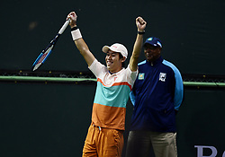 March 8, 2019 - Indian Wells, CA, U.S. - INDIAN WELLS, CA - MARCH 08: Kei Nishikori (JPN) reacts after hitting a deep lob for a winner in the second set of a doubles match during the BNP Paribas Open played at the Indian Wells Tennis Garden in Indian Wells, CA. (Photo by John Cordes/Icon Sportswire) (Credit Image: © John Cordes/Icon SMI via ZUMA Press)