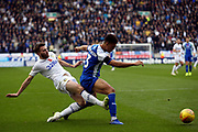 Leeds United midfielder Stuart Dallas (15) and Wigan Athletic defender Antonee Robinson (3) during the EFL Sky Bet Championship match between Wigan Athletic and Leeds United at the DW Stadium, Wigan, England on 4 November 2018.