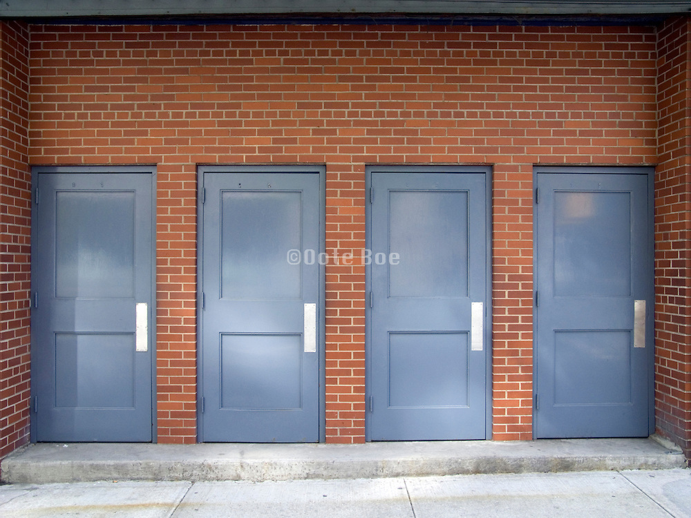 4 identical doors next to each other