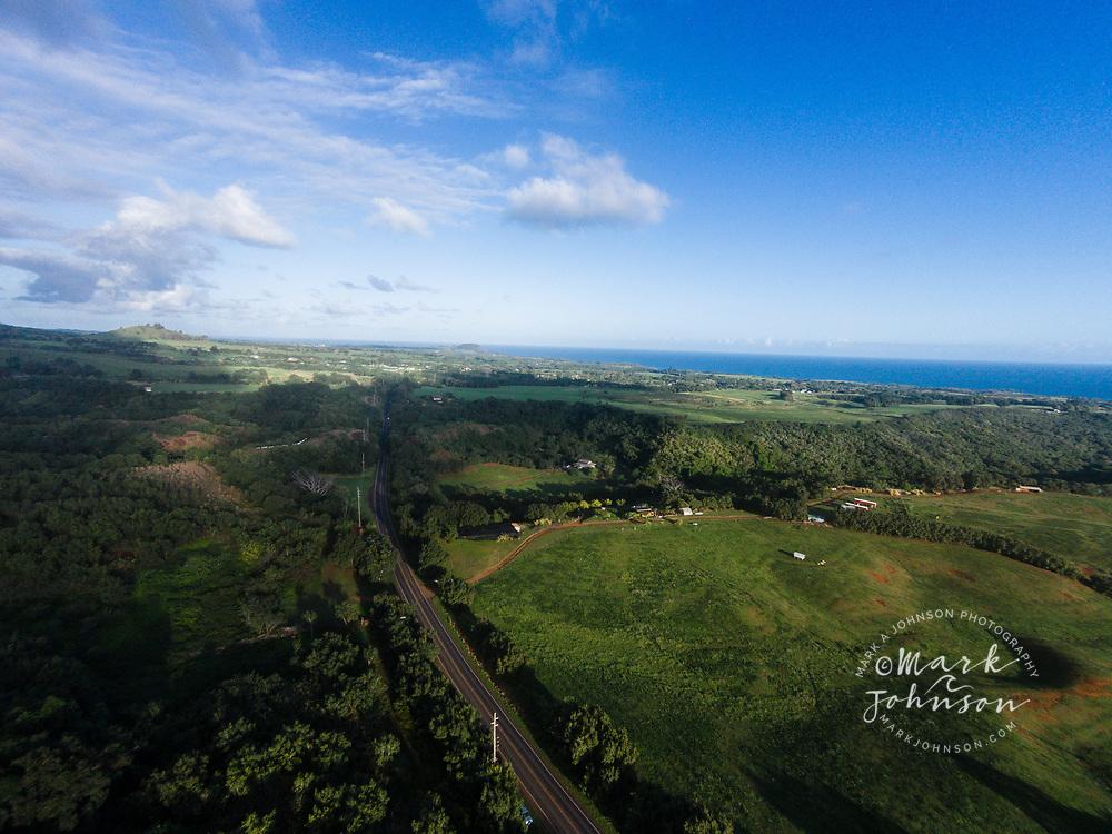 Aerial photograph of Kuhio Highway along the Moloa'a Mountains, Kauai, Hawaii