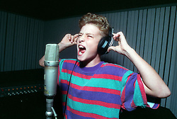 Aug. 10, 1992 - U.S. - FILE August 10, 1992 - Justin Timberlake, 11, belts out When a Man Loves a Woman during a 1992 taping session at Ardent Studios in Memphis. An executive for Columbia and Epic Records asked Justin to make the recording after seeing the sixth-grader at a talent contest. Timberlake turns 30 on Monday, January 31, 2011. (Credit Image: © The Commercial Appeal/ZUMAPRESS.com)
