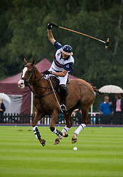 An England polo player during the Royal Salute Coronation Cup polo at Windsor Great Park in Surrey.