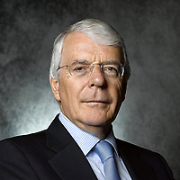 Often commissioned by Corporate & Government Clients for Portrait Sittings. I'm no stranger to photographing headshots of prominent business, legal and political officials. Non of these sittings have been more unique than a photoshoot with Sir John Major, former Prime Minister of Great Britain.<br /> I wrote to Sir John in 2016 to arrange the sitting and we decided to shoot in the Autumn of that year. However, Brexit came upon us and the sitting was postponed. Sir John, being a remain campaigner had to take time out. It wasn't until July 2018, that the sitting could finally take place.<br /> To prepare for my sitting, I began by studying Sir John's portrait sitting with Yousuf Karsh, before watching his interviews and parliamentary debates on Youtube. I also read Sir John's Autobiography to get a sense of his character and career as Prime Minister.<br /> Preparation complete, my plan was to capture Sir John as the elder statesman, thoughtful and reflective. I found Major to be an extraordinary sitter. Speaking about his career, I was able to direct Sir John as he mediated on the past. One of my aims as a portraitist is to record the figures of our time, and this sitting certainly represents living history.