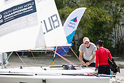 World Sailing Emerging Nations Program - Boca Chica Sailing Club, Santo Domingo 08/19/2017 - DAY 1- David Douglas, coach from Turks and Caicos helps Yisel Alfonso Peña from Cuba in the arrangements before practice