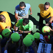 Gael Monfils, France, signing autographs after his win against Alejandro Gonzalez, Colombia, during the US Open Tennis Tournament, Flushing, New York, USA. 29th August 2014. Photo Tim Clayton