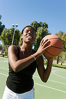 Young Woman Shooting the Ball