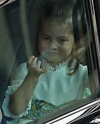 Princess Charlotte arrives for the wedding of Princess Eugenie to Jack Brooksbank at St George's Chapel in Windsor Castle.
