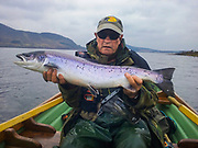 "Mayo County. The ""ghillie"" Eamonn Kennedy. The Ghillies acts as guides, helping the salmon anglers. Eamonn works for Newport House"",  a elegant Georgian country house, celebrated worldwide by salmon anglers."