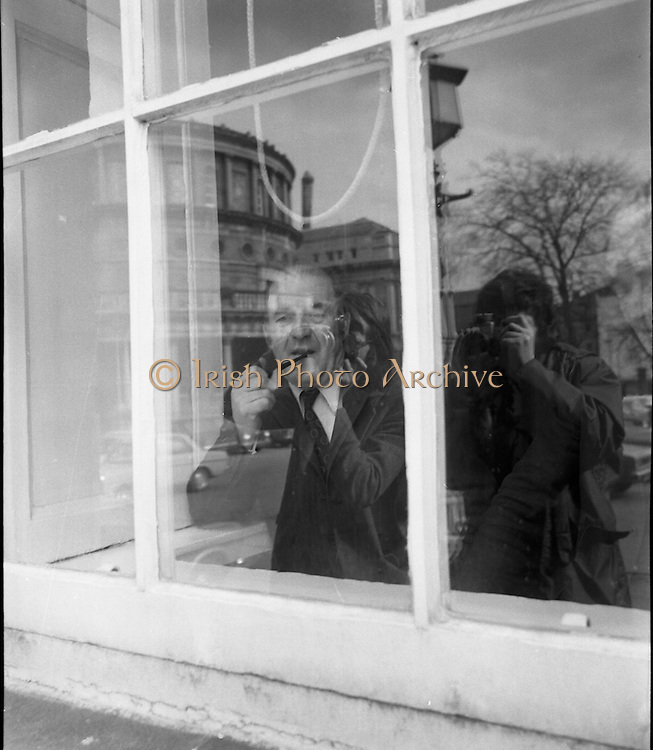 Dail Reassembles at Leinster House..1973..28.03.1973..03.28.1973..28th March 1973..After the recent general election The Dail resumed today at Leinster House,Dublin..The snappers are snapped! Picture shows two photographers captured in the glass reflection of Leinster House.