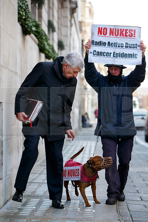 © Licensed to London News Pictures. 23/02/2015. LONDON, UK. Ex-Foreign Secretary Jack Straw, who suspended from Labour Party after being secretly filmed apparently offering their services to a private company for cash, reacting to a protester outside Milbank studios in central London on Monday, 23 February 2015. Photo credit : Tolga Akmen/LNP