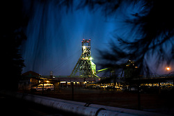 The shaft of a gold mine on the outskirts of Carletonville is seen at dawn. South African Gold miners are particularly vulnerable to contracting TB because of the small, poorly ventilated work and living conditions, high rates of HIV and high rates of silicosis, a lung disease often found in miners that increases the chance of catching TB.