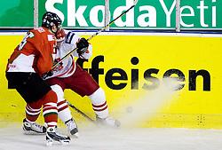 MAGOSI Bálint of Hungary  vs KLYS Jaroslaw of Poland at IIHF Ice-hockey World Championships Division I Group B match between National teams of Hungary and Poland, on April 18, 2010, in Tivoli hall, Ljubljana, Slovenia.  (Photo by Vid Ponikvar / Sportida)