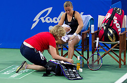 Anastasiya Yakimova of Belarus is assisted after injury at 2nd Round of Singles at Banka Koper Slovenia Open WTA Tour tennis tournament, on July 22, 2010 in Portoroz / Portorose, Slovenia. (Photo by Vid Ponikvar / Sportida)
