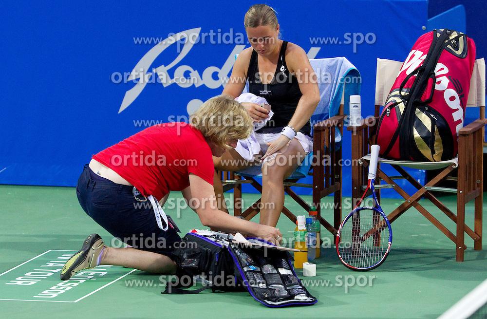 Anastasiya Yakimova of Belarus is assisted after injury at 2nd Round of Singles at Banka Koper Slovenia Open WTA Tour tennis tournament, on July 22, 2010 in Portoroz / Portorose, Slovenia. (Photo by Vid Ponikvar / Sportida)