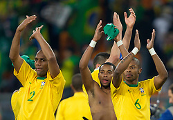 Players of Brazil Maicon, Robinho, Michel Bastos after the 2010 FIFA World Cup South Africa Group G Second Round match between Brazil and République de Côte d'Ivoire on June 20, 2010 at Soccer City Stadium in Soweto, suburban Johannesburg, South Africa.  Brazil defeated Ivory Coast 3-1. (Photo by Vid Ponikvar / Sportida)