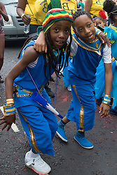 London, August 28th 2016. Two little boys dance in the street during Family Day at Europe's biggest street party, the Notting Hill Carnival.