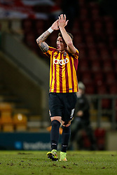 Christopher Routis of Bradford City applauds the supporters after his side win 4-0 to set up a match during at Chelsea in the 4th round - Photo mandatory by-line: Rogan Thomson/JMP - 07966 386802 - 14/01/2015 - SPORT - FOOTBALL - Bradford, England - Coral Windows Stadium - Bradford City v Millwall - FA Cup Third Round Replay.