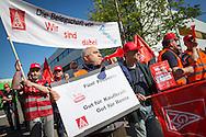 Berlin, Germany -  02.05.2016 <br /> <br /> IG Metall strike rally outside the Pierburg factory in Berlin-Wedding. Employees of the morning shift lay down tools and block the factory gate. Also striking Bosch employees join they rally. The union IG Metall demands in the current Germany-wide wage negotiations in the metal industry, among others 5% rise in wages.<br /> <br /> IG-Metall Warnstreik Kundgebung vor dem Pierburg Werk in Berlin-Wedding. Beschaeftigte der Fruehschicht des Unternehmens legen die Arbeit nieder und blockieren die Werkszufahrt. Unterstuetzt werden sie dabei von Bosch-Beschaeftigten die ebenfalls in den Warnstreik traten. Die Gewerkschaft IG-Metall fordert in der aktuellen deutschlandweiten Tarifauseinandersetzung in der Metall-Branche u.a. 5% mehr Lohn.  <br /> <br /> Photo: Bjoern Kietzmann