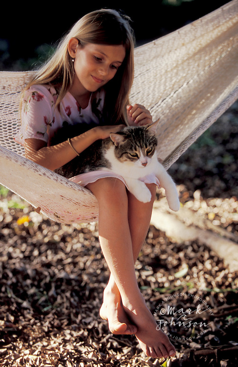 9 year old girl on hammock with her cat people *****Property Release available ****Model Release available