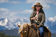 Amy Finger rides her horse to patrol the Hardscrabble Mountain Trail Run at Bear Basin Ranch, to benefit the San Isabel Land Protection Trust.